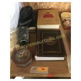 Dictionary, hat, jewelry box, camera