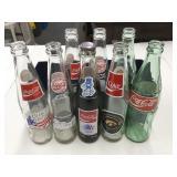 (8) Coca-Cola Bottles