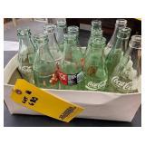 (13) Coca-Cola Bottles