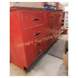 12 drawer metal cabinet. With wooden top.