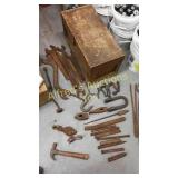 Old wood tool box with tools. Chisels hammerheads