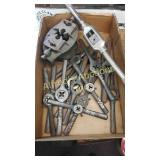 Collection of dies and a large tap wrench.