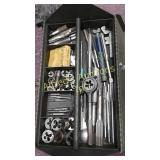 Tool box filled with tap and dies.