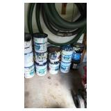 14 open cans of pool paint in different colors