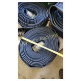 Roll of blue flat hose with couplers