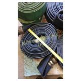 Roll a blue flat hose with couplers.