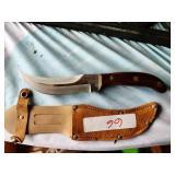 Tramontina wood handle hunting knife.
