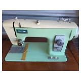 sewing machine and cabinet -42  untested