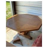 Wood hex table -55  needs part of leg repaired-