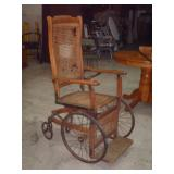 VERY OLD WICKER SEAT WHEEL CHAIR