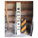 Metal Westgate and caution signs