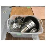 Bin of assorted stainless inserts in bowls