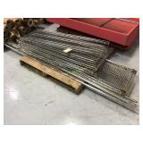 Pallet of wire shelving with four poles