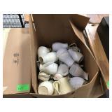 Large box of plastic coffee servers