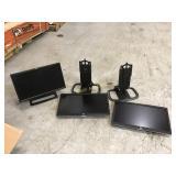 Three HP monitors with chords