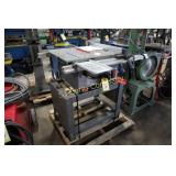 "Ryobi  BT3000  10"" contractor table saw on stand"