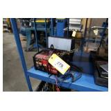 Lot:  Schumacher speed charger and Husky 12v