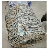 Unused roll of barbed wire