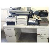 Metal desk with multiple printers and office