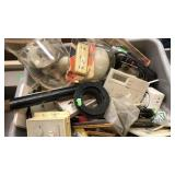 Tote of electrical maintenance items
