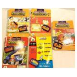 5 leap pad books and cartridges
