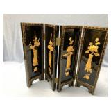 A Chinese hand made lacquer four section divider w