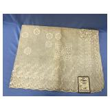 A beautiful lace table cloth 54 X 72 in. with orig