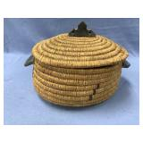 Hand woven lidded grass basket with seal skin inte