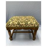 antique footstool, upholstery is in good condition