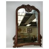 Beveled glass mirror set in a lovely wooden frame