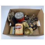 Box with assorted brass items, cast iron trivets,