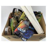 Box full of older paperback books and Star Wars ac