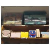 Shelf lot with dolls, Christmas decorations, trunk