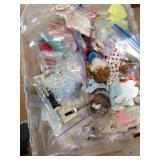 Lot with 2 plastic totes with doll clothes, perfum