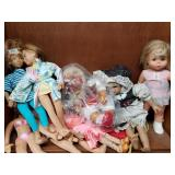 Shelf lot with different size and make dolls, batt