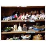 Shelf lot with different dressed dolls most are th