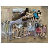 Shelf lot with mini dolls in plastic bags most the