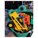 Vinyl bag full with kids toys, plastic trucks, fis