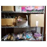 Shelf lot with dolls clothes, doll metal stands, m