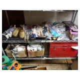Shelf lot with different sizes dolls, doll clothes