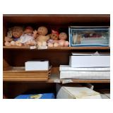 """Shelf lot with cabbage patch dolls and 16"""" Brikett"""