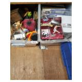 3 plastic totes full with home decorations, paper