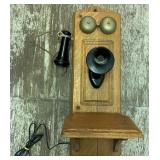 Vintage wall hanging dial phone in wood cabinet br