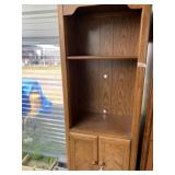 Wooden storage cabinet with doors and shelves in g