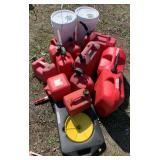 Large lot w/different size gas cans and oil trays,