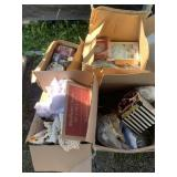 Lot with boxes including wall clock, toys, doll cl