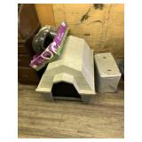 Lot with plastic dog house motorcycle helmets and