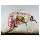 Lot with an Ed Hardy jacket, rose bowl footballs,
