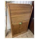 Vintage roll top cabinet with doors and shelves in
