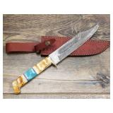 Damascus Bowie style knife with brass guard, bone